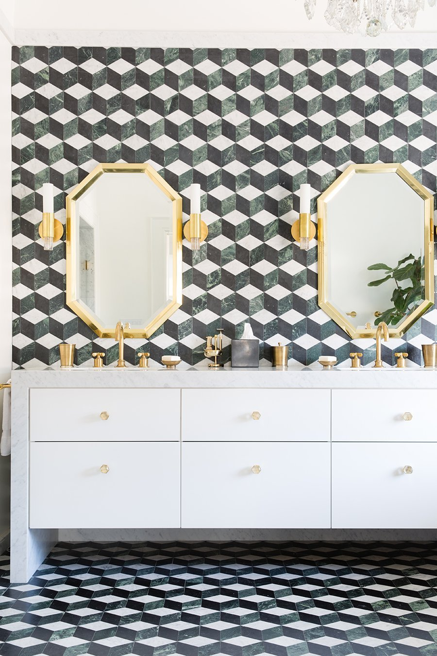 Caden Sconce and Thea Large Knob by Matthew Studios in Clear Quartz and Polished Brass. Interiors by HSH Interiors.