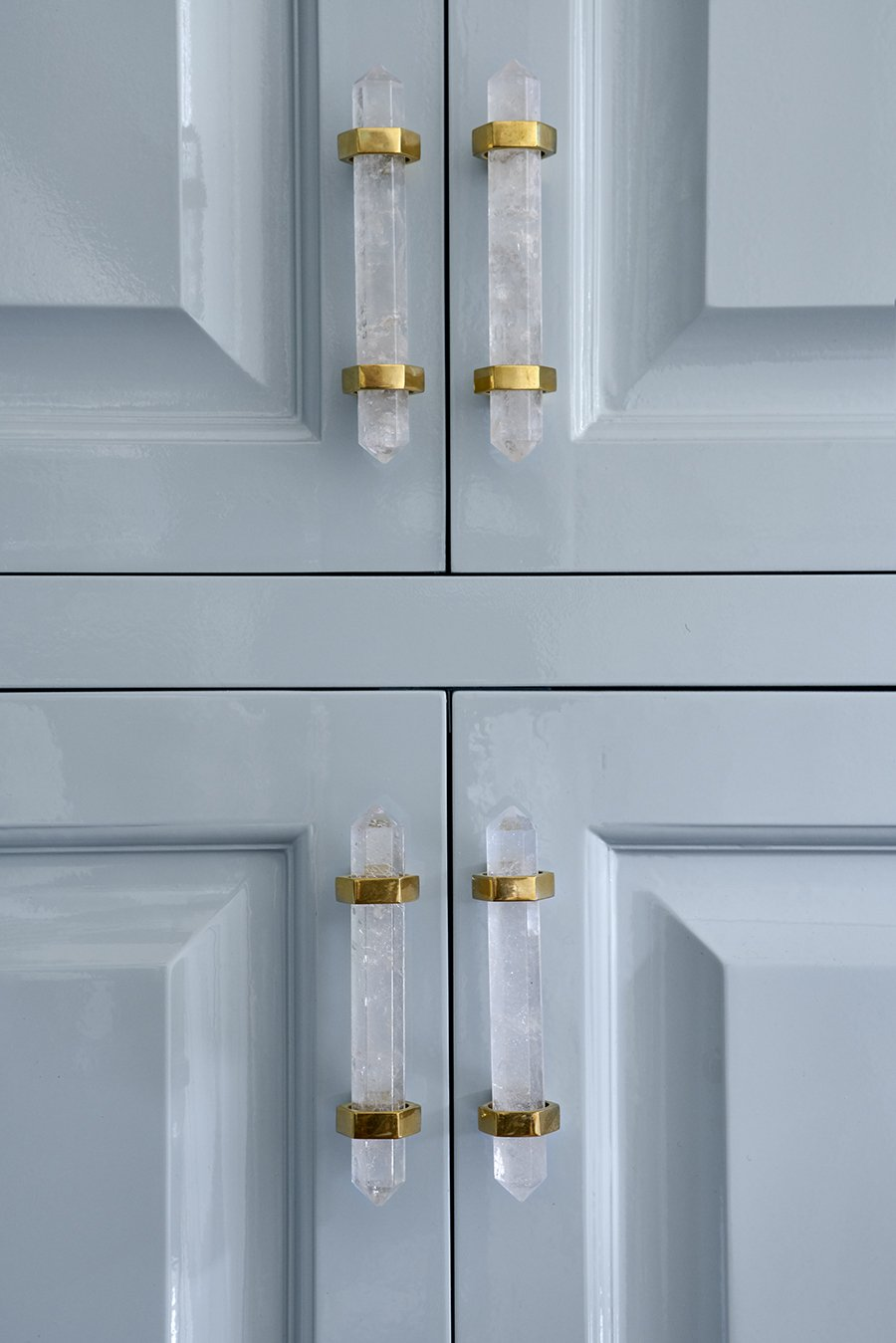 Freya Medium Pull by Matthew Studios in Clear Quartz and Polished Brass. Interiors by Collins Interiors.
